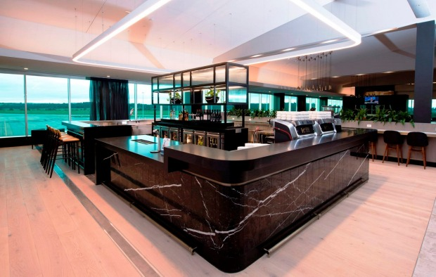 Dark finishes and marble from Spain reflect Melbourne's chic, urban feel: Qantas domestic business lounge, Melbourne Airport.