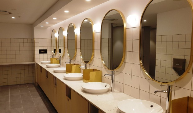 Bathroom mirrors inside the new Qantas Business Lounge.