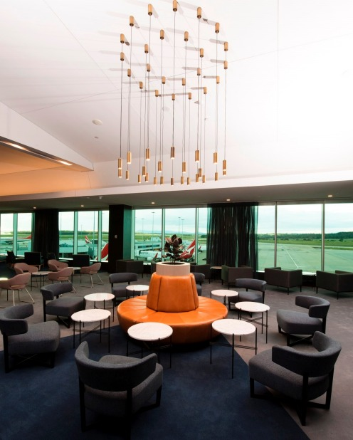 Designed by Woods Bagot, the antas domestic business lounge, Melbourne Airport, reflects the chic, urban aesthetic of ...