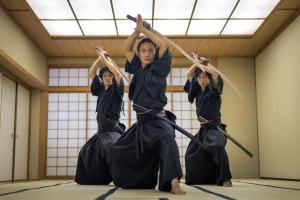 Japanese martial arts athlete training kendo in a dojo.