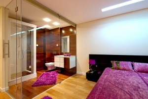 A rising trend in hotel design is to only have glass walls separating the main room from the bathroom.