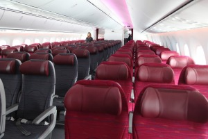 The interior of the standard class cabin where seat pitch and width are noticeably generous.