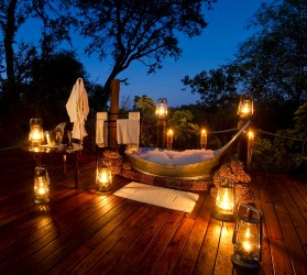 A LANTERN-LIT BATH BAINES SANCTUARY CAMP, BOTSWANA  With just five suites, Baines Sanctuary Camp is one of Africa's most ...