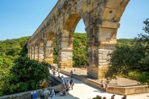 Pont du Gard, a mighty aqueduct bridge rising over three arched tiers, built by first-century Romans.