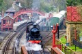 A vintage passenger steam train leaves Goathland Station on the way to Whitby on the North Yorkshire Moors Railway.
