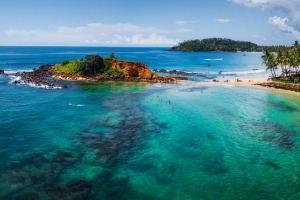 The beach and coral reef at the Sri Lankan seaside town of Mirissa.