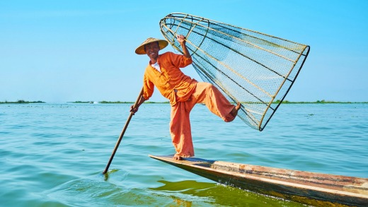 Some of the Intha leg rowers of Myanmar's Inle Lake now depend on tourists with cameras to supplement their income.