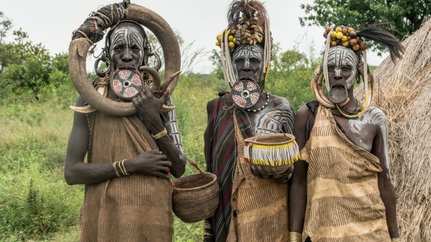 The tribes of Ethiopia's Omo Valley, who practice a particularly exotic form of body art, are now dressing up solely for ...