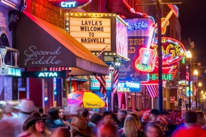 Lower Broadway where country music rolls out of the neon-dipped honky tonks.