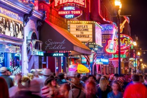 Lower Broadway, where country music rolls out of the neon-dipped honky tonks.