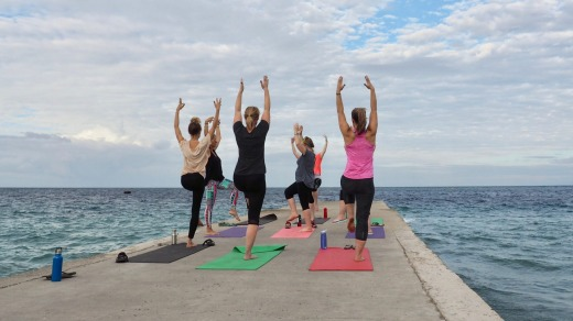 Oceanfront yoga is one of many activities you can enjoy in Timor-Leste.
