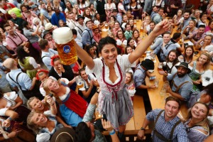 A young woman celebrates the opening of 'Oktoberfest' beer festival in Munich.