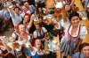 Thousands of visitors, many of them dressed in traditional lederhosen or dirndl corseted dresses, descended on Munich on ...