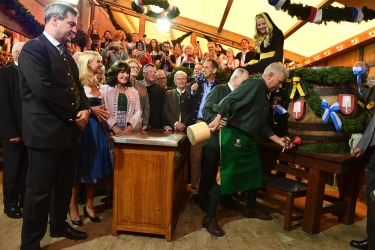 Munich's mayor, Dieter Reiter, kicked off the festivities by tapping open the first beer keg with a traditional shout of ...