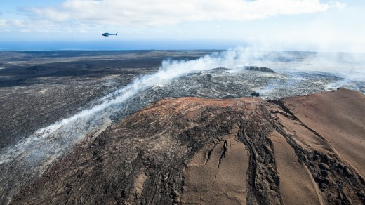 Helicopter tour flies over lava flow, Hawaii Island.