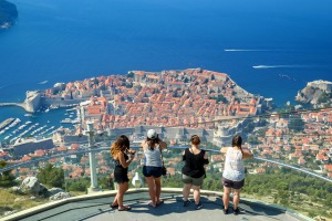 <i>Tourists at a viewpoint on Srd hill looking at Dubrovnik panorama in Dubrovnik, Croatia.</i>