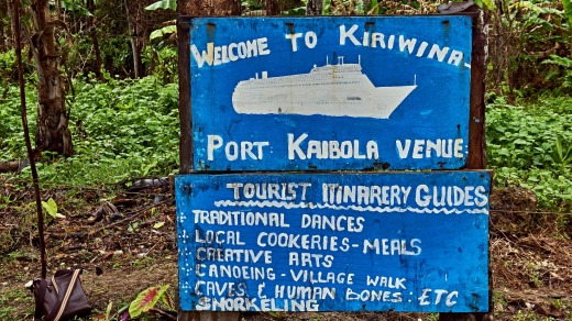 Hand painted tourist sign at Kiriwina Port Kaibola, Kiriwina Island.