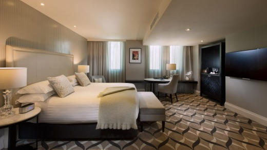 A Deluxe King Room at Mayfair Hotel Adelaide.