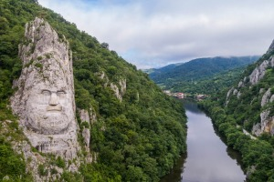 The 130 kilometres of narrow limestone gorges that channel the Danube through the Carpathian Mountains along the ...