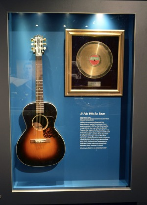 Slim Dustry's Gibson guitar  and gold record for <i>A Pub With No Beer</i> at the Slim Dusty Centre.