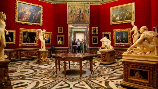 The Tribuna of the Uffizi, a domed octagonal room displaying paintings and statues.