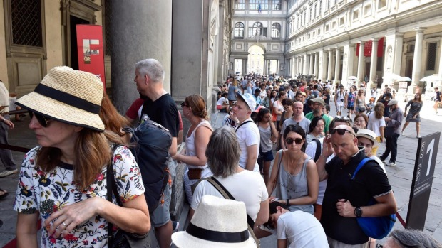 Tourists queue to enter the Uffizi during summer last year.
