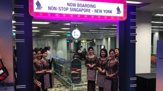 The famous Singapore Girls welcome passengers aboard the inaugural flight.