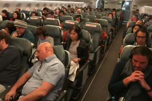 Halfway there. Passengers relax in the premium economy cabin.