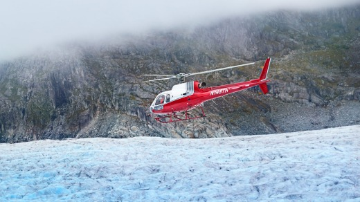 A helicopter landing on Mendenhall Glacier.