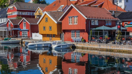 Colorful clapboard houses on the waterfront of Kragero, Norway.