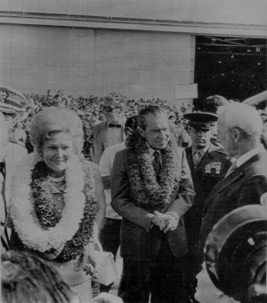 President Richard M. Nixon and wife Pat with leis around their necks chat with Hawaii Governor John A. Burns (R) on ...