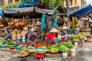 Fresh vegetables in a traditional street market in Hoi An, Vietnam.