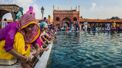 People wash themselves with water from an artificial pond at the premises of Jama Masjid, Delhi, as they prepare for ...