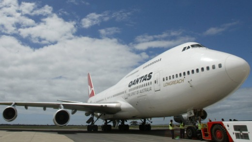 Qantas used a Boeing 747 jumbo jet for its final international flight before grounding most of its fleet.