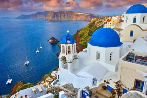 Fira town on Santorini island, Greece. Incredibly romantic sunrise on Santorini. Oia village in the morning light. ...