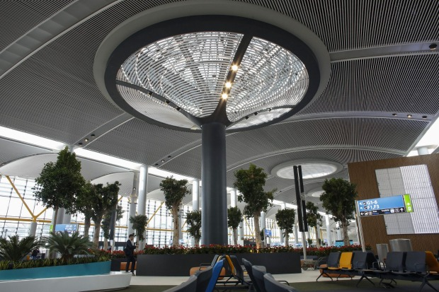 A visitor walks through the main hall of Terminal 3.