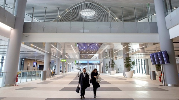 Visitors walk through Terminal 3 at Istanbul New Airport before the opening in Istanbul.