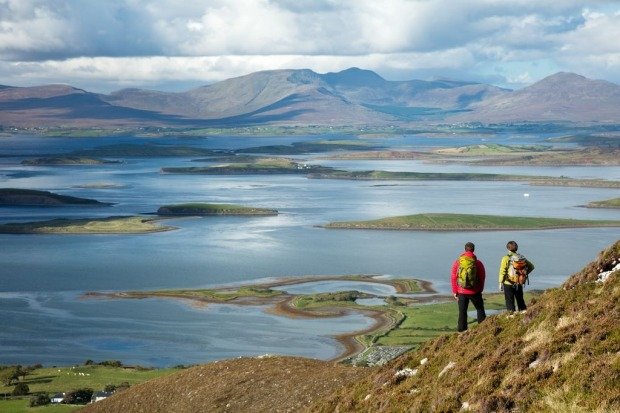 Walkers on the slopes of Croagh Patrick, above Clew Bay, Co. Mayo, Ireland.