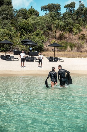 Staff await with Dom Perignon after snorkelling at Lizard Island.