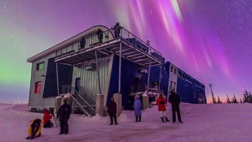 Tourists enjoy the start of a fine display of Northern Lights at the Churchill Northern Studies.