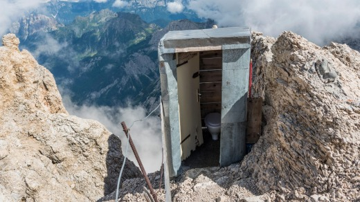 An outdoor toilet on the highest peak of the Dolomites, Italy.