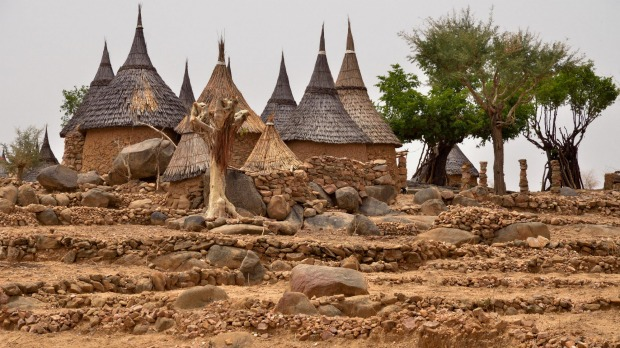 A village with typical thatched circular huts in the Mandara Mountains.
