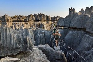 Beautiful tourist on an excursion in the unique limestone landscape at the Tsingy de Bemaraha Strict Nature Reserve in ...