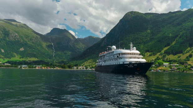 An APT ship cruises the Norwegian fiords.