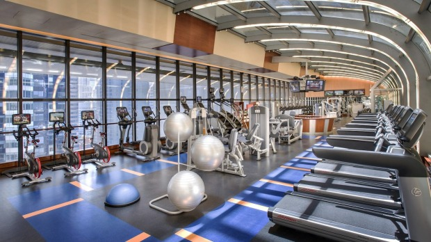 The Marriott's modern gym has floor-to-ceiling windows overlooking Times Square.