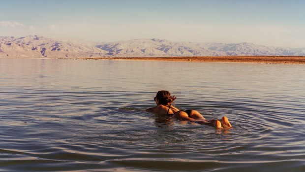 Keep your face out of the water: Swimming in the Dead Sea.