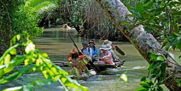 Be escorted to the village aboard an outrigger canoe, Papua New Guinea.