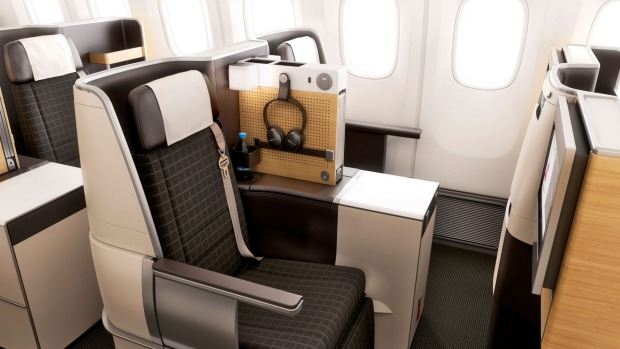 Business-class seats on Swiss International Air Lines' Boeing 777-300ERs are flatbed, and there's a compartment for ...
