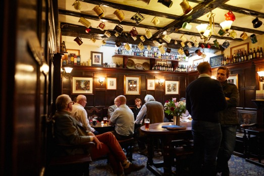 YE OLD MITRE: In the 18th century, beer houses often had saloons for entertainment such as gaming, singing or billiards, ...