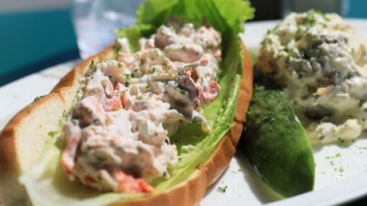 Lobster rolls served with pickle and potato salad at Provincetown's Lobster Pot.